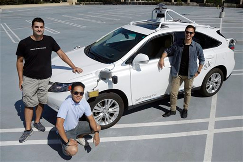 Brian Torcellini, Google team leader of driving operations, right, poses for photos with vehicle safety specialists Rob Miller, top left, and Ryan Espinosa, next to a vehicle at a Google office in Mountain View, Calif on August 24, 2015. Photo: AP