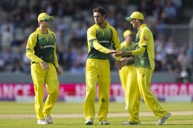 Australia's Glenn Maxwell (centre) is congratulated by teammates after taking the wicket of England's Eoin Morgan, caught by Mitchell Starc for 62 during the One-Day International cricket match between England and Australia at Old Trafford cricket ground in Manchester, England, Tuesday, September 8, 2015. Photo: AP