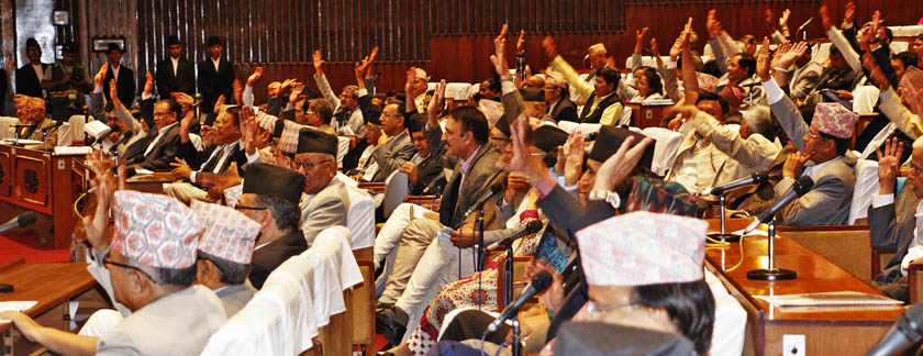 Lawmakers raise their hands to endorse an article of Revised Bill of new constitution at the Constituent Assembly on Monday, September 14. 2015. Photo: RSS