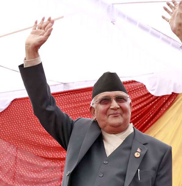 CPN-UML Sharma KP Sharma Oli waves his hand from the dais during a special function organised by the three major parties at Tundikhel a day after the promulgation of Nepal's Constitution, on Monday, September 21, 2015. Photo: RSS