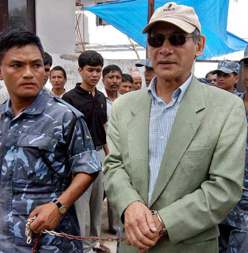 FILE - A Nepali security personnel takes serial killer Charles Sobhraj to the court for a hearing in Katmandu, Nepal, on Monday, July 5, 2004. A court in Nepal delayed its verdict Monday on Sobhraj, accused of a string of murders of young tourists across Asia and the Middle East in the 1970s, saying it needed additional documents. Photo: AP Photo/Binod Joshi)
