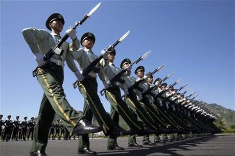 Chinese troops practice marching ahead of a Sept. 3 military parade at a camp on the outskirts of Beijing, Saturday, Aug. 22, 2015. AP