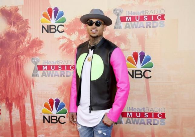 Singer Chris Brown poses at the 2015 iHeartRadio Music Awards in Los Angeles, California, March 29, 2015. REUTERS/Danny Moloshok/Files