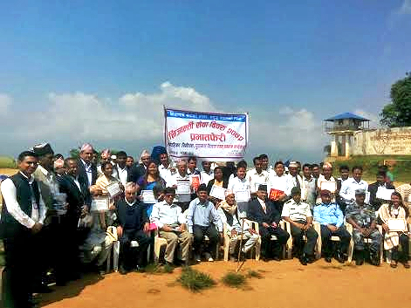 Civil servant staff posing for a photograph during  a programme organised to celebrate the Civil Service Day in Bhojpur district, on Tuesday, September 08, 2015. Photo: Niroj Koirala