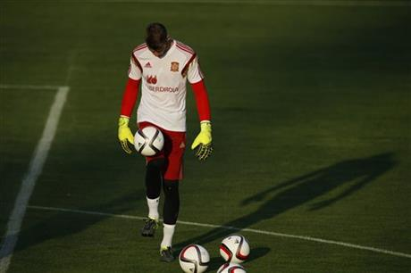 Spain's goalkeeper David de Gea plays with a ball during a training session with the Spanish national team in Las Rozas on the outskirts of Madrid, Spain, Wednesday Sept. 2, 2015. AP