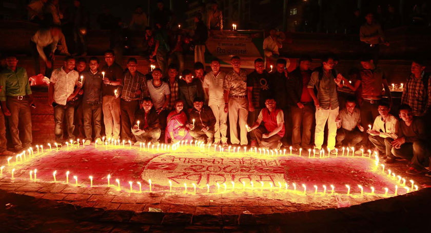 A group of youth light candles at Maitighar Mandala on as the Constituent Assembly endorsed all the articles of draft constitution on Wednesday evening, September 16, 2015. Photo: RSS