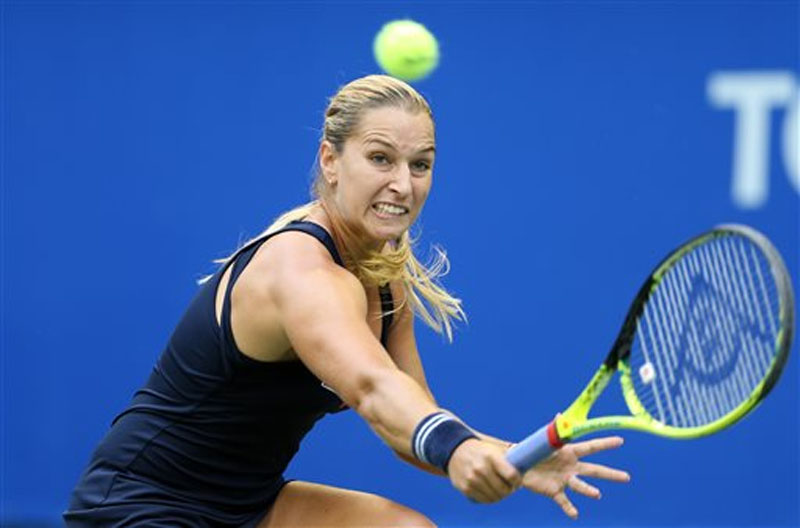 Dominika Cibulkova of Slovakia returns a ball against Carla Suarez Navarro of Spain, during the second round of the Pan Pacific Open womenu2019s tennis tournament in Tokyo on Thursday, September 24, 2015.