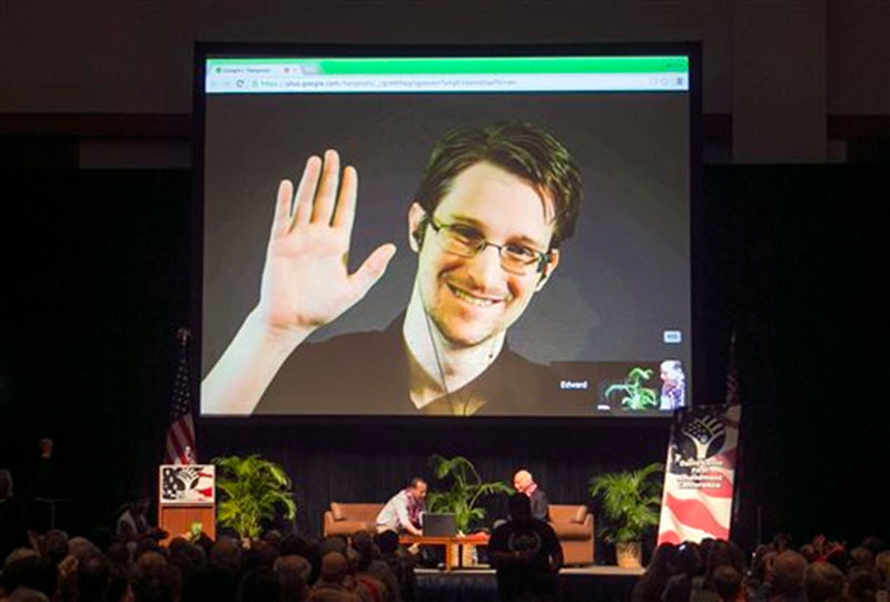 Edward Snowden appears on a live video feed broadcast from Moscow at an event sponsored by ACLU Hawaii in Honolulu on February 14, 2015. Photo: AP