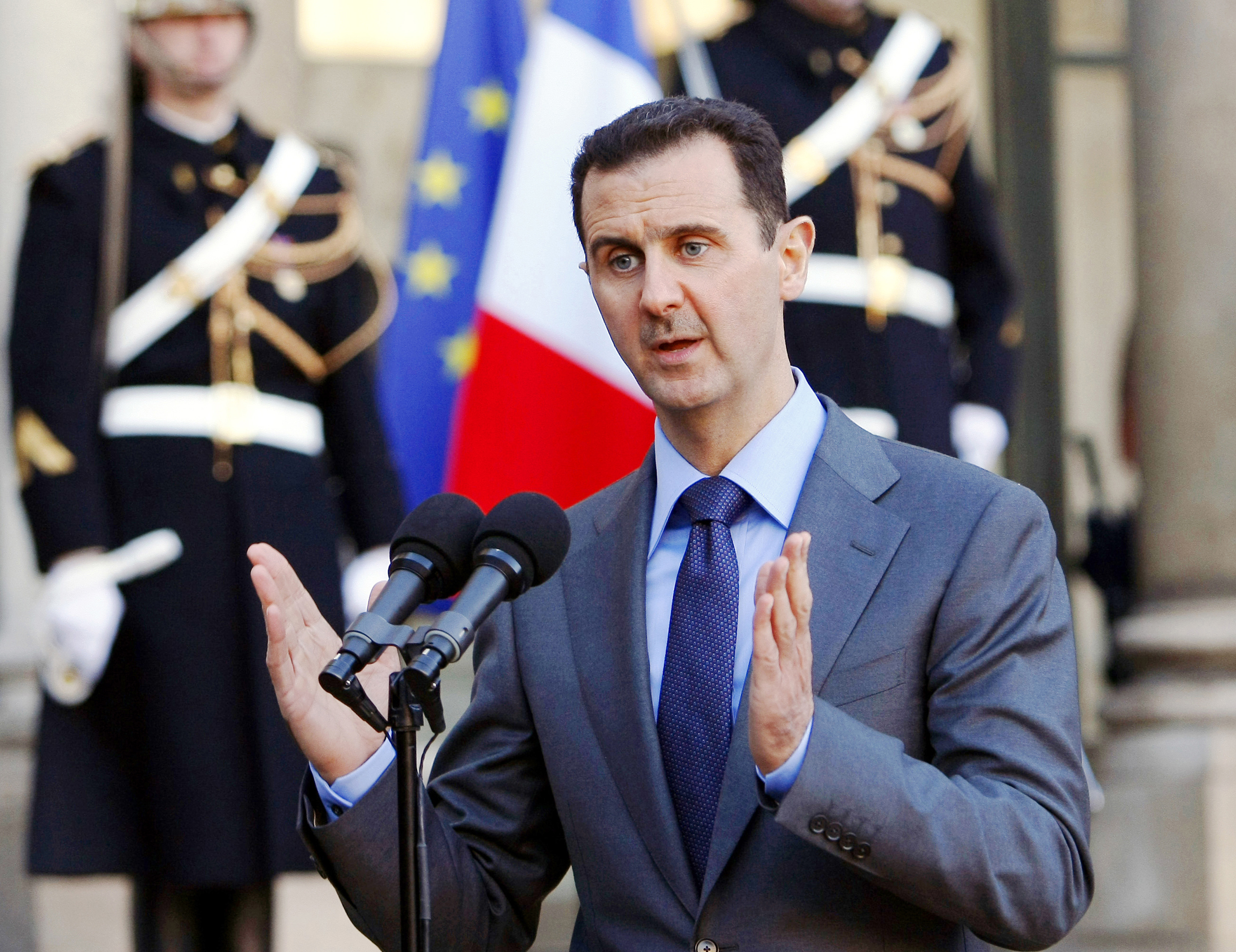 FILE - In this Thursday Dec. 9, 2010 file photo, Syria President Bashar al-Assad addresses reporters following his meeting with French President Nicolas Sarkozy at the Elysee Palace in Paris, France. Paris prosecutors have opened a preliminary investigation into French government accusations that Syrian President Bashar Assad's government has committed crimes against humanity. The prosecutor's office said Wednesday the investigation is based on photos taken by a former Syrian officer who fled in 2013 and focuses on atrocities allegedly committed between 2011 and 2013. (AP Photo/Remy de la Mauviniere, File)