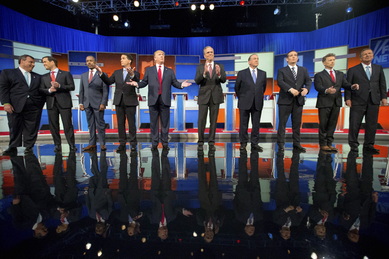FILE - In this Aug. 6, 2015, file photo, Republican presidential candidates from left, Chris Christie, Marco Rubio, Ben Carson, Scott Walker, Donald Trump, Jeb Bush, Mike Huckabee, Ted Cruz, Rand Paul, and John Kasich take the stage for the first Republican presidential debate in Cleveland.  Eleven top-tier Republican presidential hopefuls face off in their second prime-time debate of the 2016 campaign Sept. 16, in a clash between outsiders and establishment candidates under a cathedral of political conservatism. Photo: AP