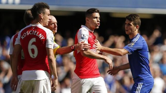 Football - Chelsea v Arsenal - Barclays Premier League - Stamford Bridge - 19/9/15nArsenal's Gabriel Paulista clashes with Chelsea's Oscar after being sent offnAction Images via Reuters / John SibleynLivepic