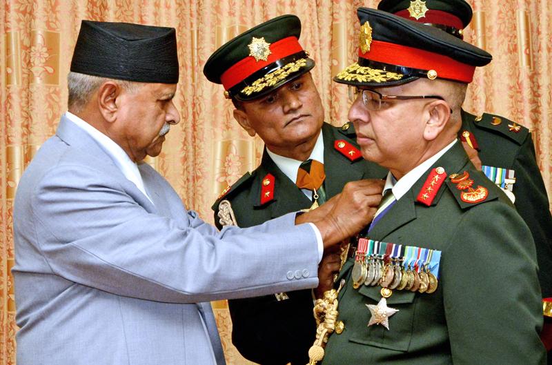 President Ram Baran Yadav conferring rank insignia on newly appointed army chief Gen Rajendra Chhetri amid a function at Shital Niwas, in Kathmandu, on Thursday. Photo: THT