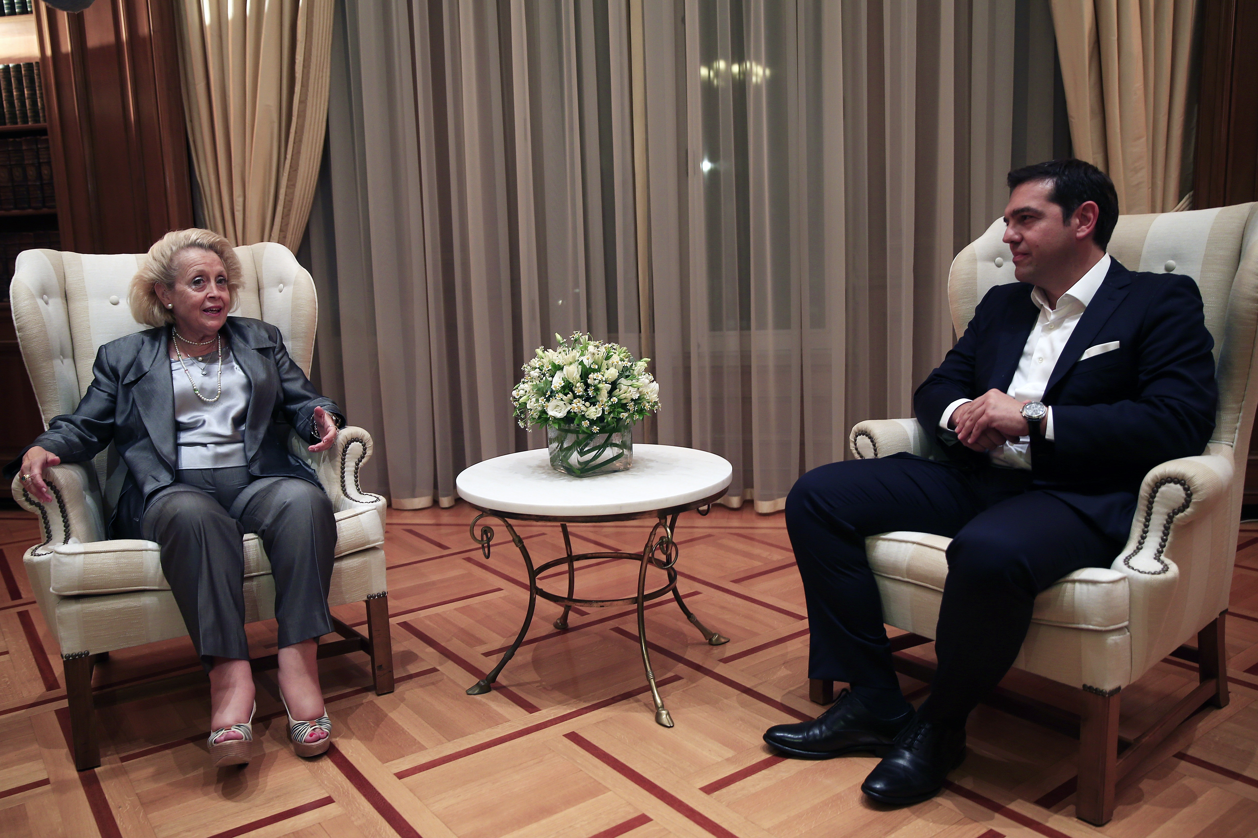 Greece's caretaker Prime Minister Vassiliki Thanou, left, speaks with the newly re-elected Prime Minister Alexis Tsipras during a hand out ceremony at Maximos Mansion in Athens, Monday, Sept. 21, 2015. Syriza's victory Sunday marks a personal triumph for Tsipras, who served as prime minister between January and August u0097 a tumultuous period that saw Greece's future in the 19-country eurozone come under real threat and strict banking controls imposed. (AP Photo/Lefteris Pitarakis)