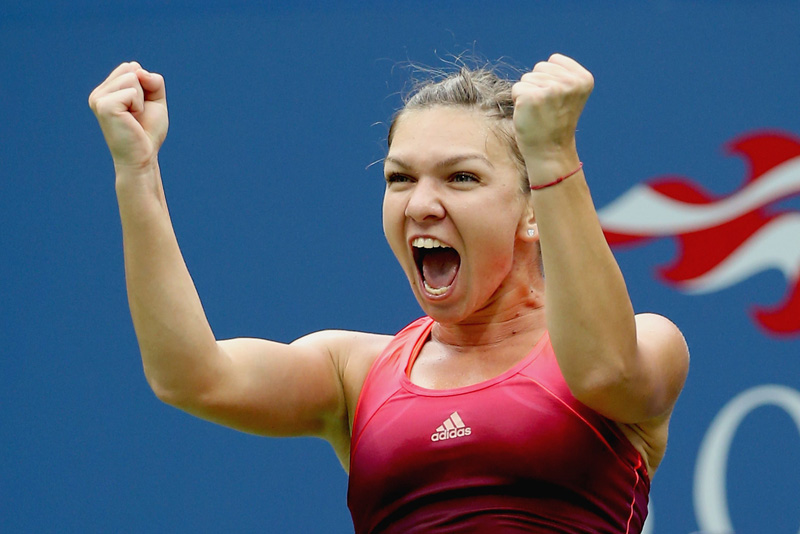 Simona Halep of Romania celebrates after beating Victoria Azarenka of Belarus during their womenu0092s singles quarter-final match of the 2015 US Open at the USTA Billie Jean King National Tennis Centre in New York on Wednesday.  Photo: AFP