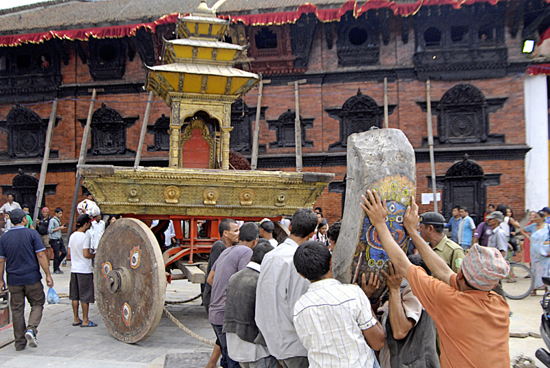 Workers trying to adjust a wooden structure onto a chariot at Basantpur, Kathmandu, on Thursday. Photo: THT