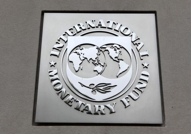 The International Monetary Fund (IMF) logo is seen at the IMF headquarters building during the 2013 Spring Meeting of the International Monetary Fund and World Bank in Washington, April 18, 2013. Photo: Reuters/ File