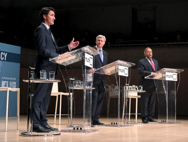 Liberal leader Justin Trudeau (L-R), Conservative leader and Prime Minister Stephen Harper and New Democratic Party (NDP) leader Thomas Mulcair are pictured during the Munk leaders' debate on Canada's foreign policy in Toronto, Canada September 28, 2015. Canadians go to the polls in a federal election on October 19, 2015. REUTERS/Fred Thornhill