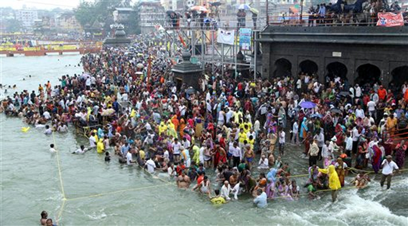 Hindu devotees gather for the third royal bath in the river Godavari during the ongoing Kumbh Mela, or Pitcher Festival, in Nashik, Maharashtra state, India, Friday, Sept. 18, 2015. Photo: AP