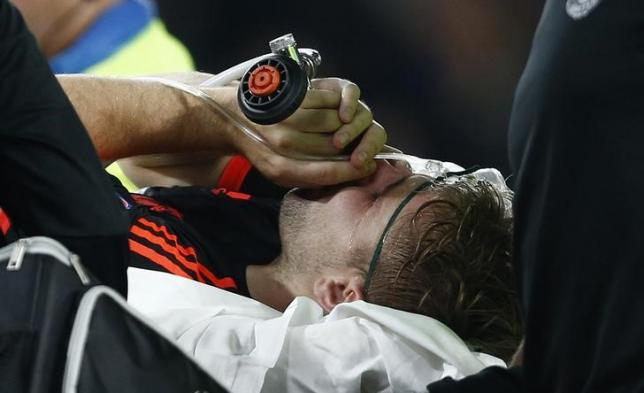 Football - PSV Eindhoven v Manchester United - UEFA Champions League Group Stage - Group B - Philips Stadion, Eindhoven, Netherlands - 15/9/15nManchester United's Luke Shaw receives treatment after sustaining an injurynAction Images via Reuters / Andrew CouldridgenLivepic