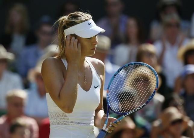 Maria Sharapova of Russia reacts during her match against Serena Williams of the U.S.A. at the Wimbledon Tennis Championships in London, July 9, 2015.                                   REUTERS/Stefan Wermuth