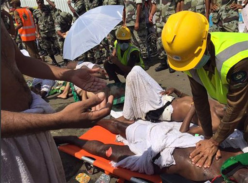 A pilgrim is treated by a medic after a stampede that killed and injured pilgrims in the holy city of Mina during the annual hajj pilgrimage on Thursday, September 24, 2015. Photo: AP