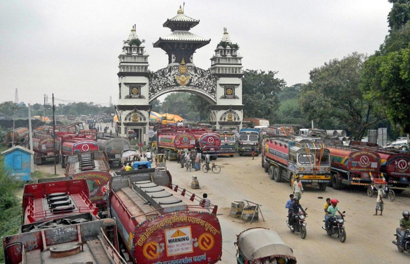 File- In this Thursday, Sept. 24, 2015 file photo, Nepali oil tankers and commercial trucks stand stranded near a gate that marks Nepal's border with India, in Birgunj, Nepal. Photo: AP