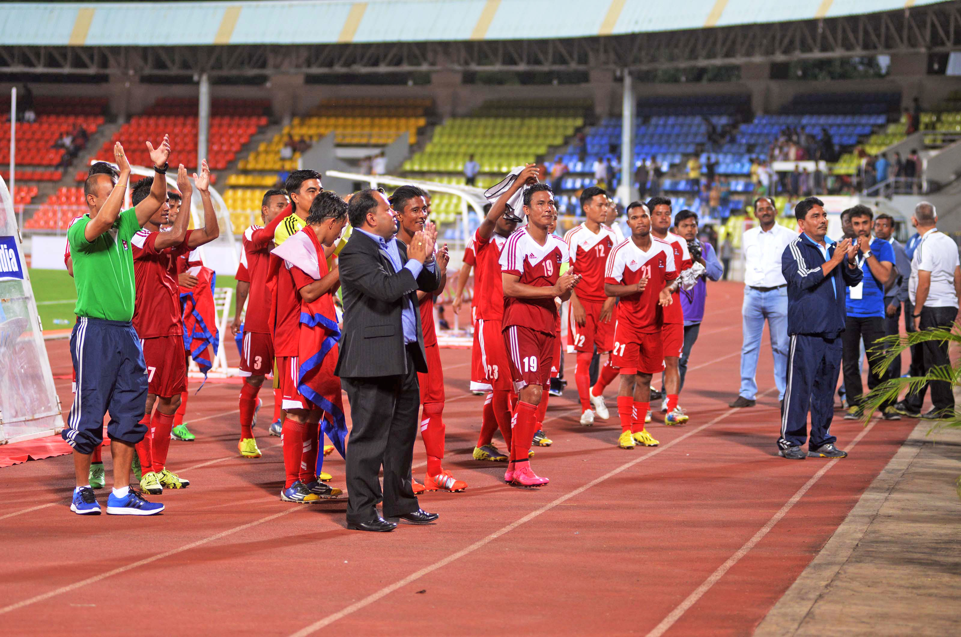 Nepali players and officials acknowledge the crowd after their international friendly match against  India at the Belwadi Stadium in Pune on Monday. Photo Courtesy : NSJF