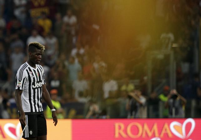 Juventus' Paul Pogba leaves the pitch at the end of the match against AS Roma in their Serie A soccer match at Olympic stadium in Rome, Italy, August 30, 2015. REUTERS/Max Rossi