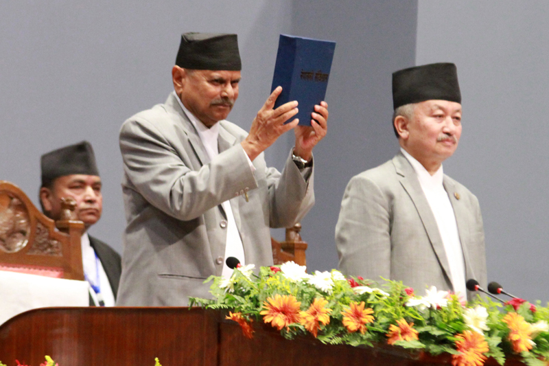 The then President Ram Baran Yadav displays a copy of Nepal's Constitution 2072 after its promulgation at the last meeting of Constituent Assembly on Sunday, September 20, 2015. Photo: RSS