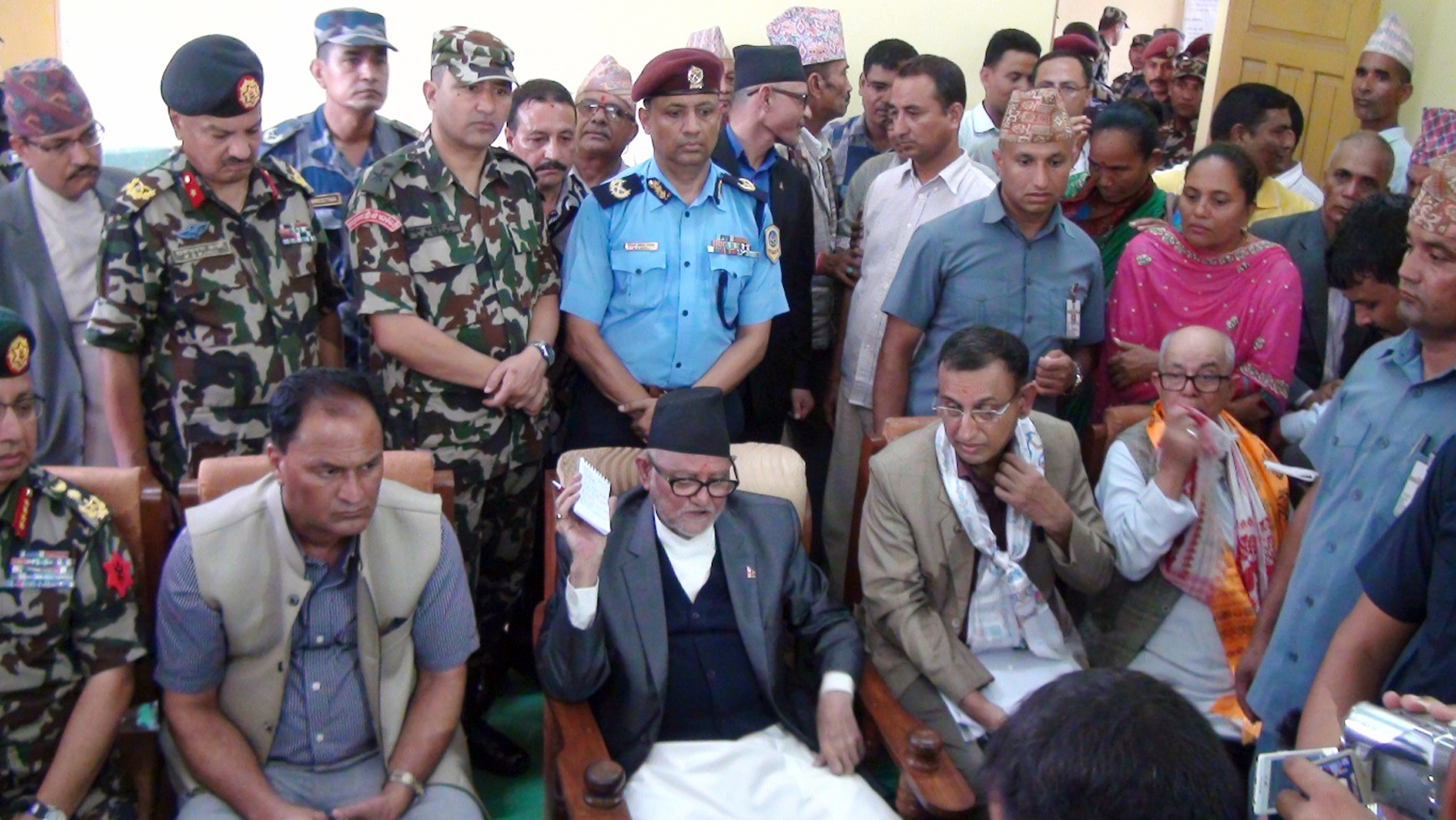 Prime Minister Sushil Koirala holding a discussion with locals about the situation after the August 24 Tikapur incident in Tikapur on Saturday, September 26, 2015. Photo: RSS
