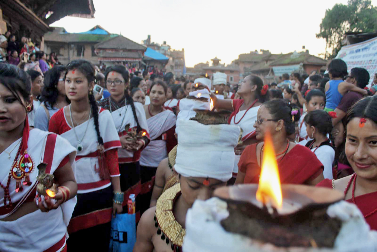 Devotees carrying oil lamp on their body parts making a round of the city on the last of Jai Jatra festival in Bhaktapur, on Sunday. Photo: RSS