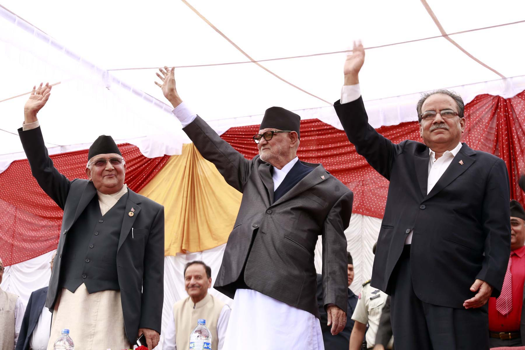 CPN-UML Chairman KP Sharma Oli (left), Nepali Congress Chairman Sushil Koirala (centre) and UCPN-Maoist Chairman Pushpa Kamal Dahal waving to the public during their joint welcome ceremony, to welcome the newly promulgated constitution, organised in Tundikhel on Monday, September 21, 2015. Photo: RSS