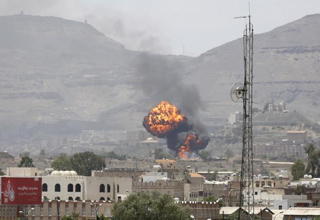 Smoke and balls of fire rise from a military base after it was hit by Saudi-led air strikes in Yemen's capital Sanaa September 10, 2015.   REUTERS/Khaled Abdullah