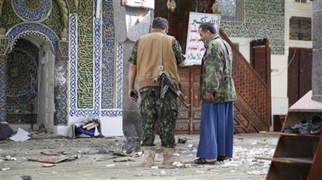 Shiite fighters, known as Houthis inspect the inside of the al-Balili mosque after two suicide bombings at the mosque during Eid al-Adha prayers in Sanaa, Yemen, Thursday, Sept. 24, 2015. AP