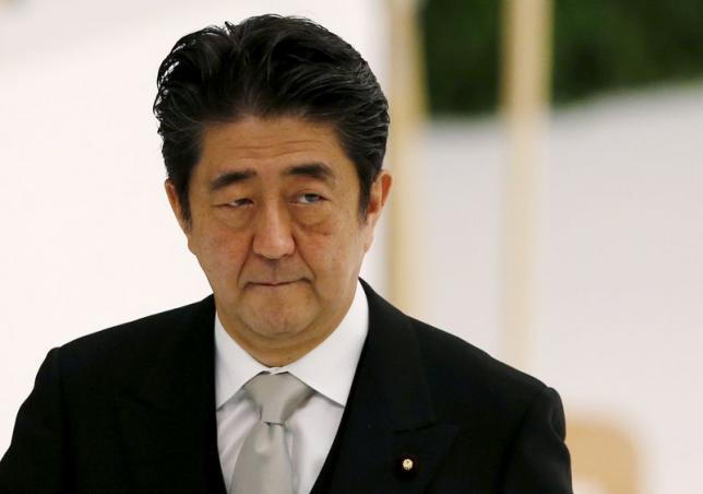 Japan's Prime Minister Shinzo Abe attends a memorial service ceremony marking the 70th anniversary of Japan's surrender in World War Two at Budokan Hall in Tokyo August 15, 2015. REUTERS/Toru Hanai