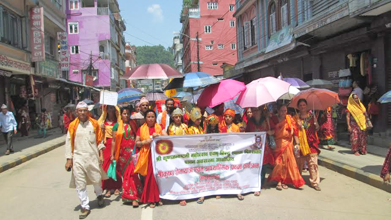 People participating in a joint rally organised by Sanatan Dharma Sewa Samiti and World Hindu Federation on the occasion of Shree Krishna Ashtami at Chapaghat of Byas-8 Municipality in Tanahun district, on Saturday, September 05, 2015. Photo: Madan Wagle