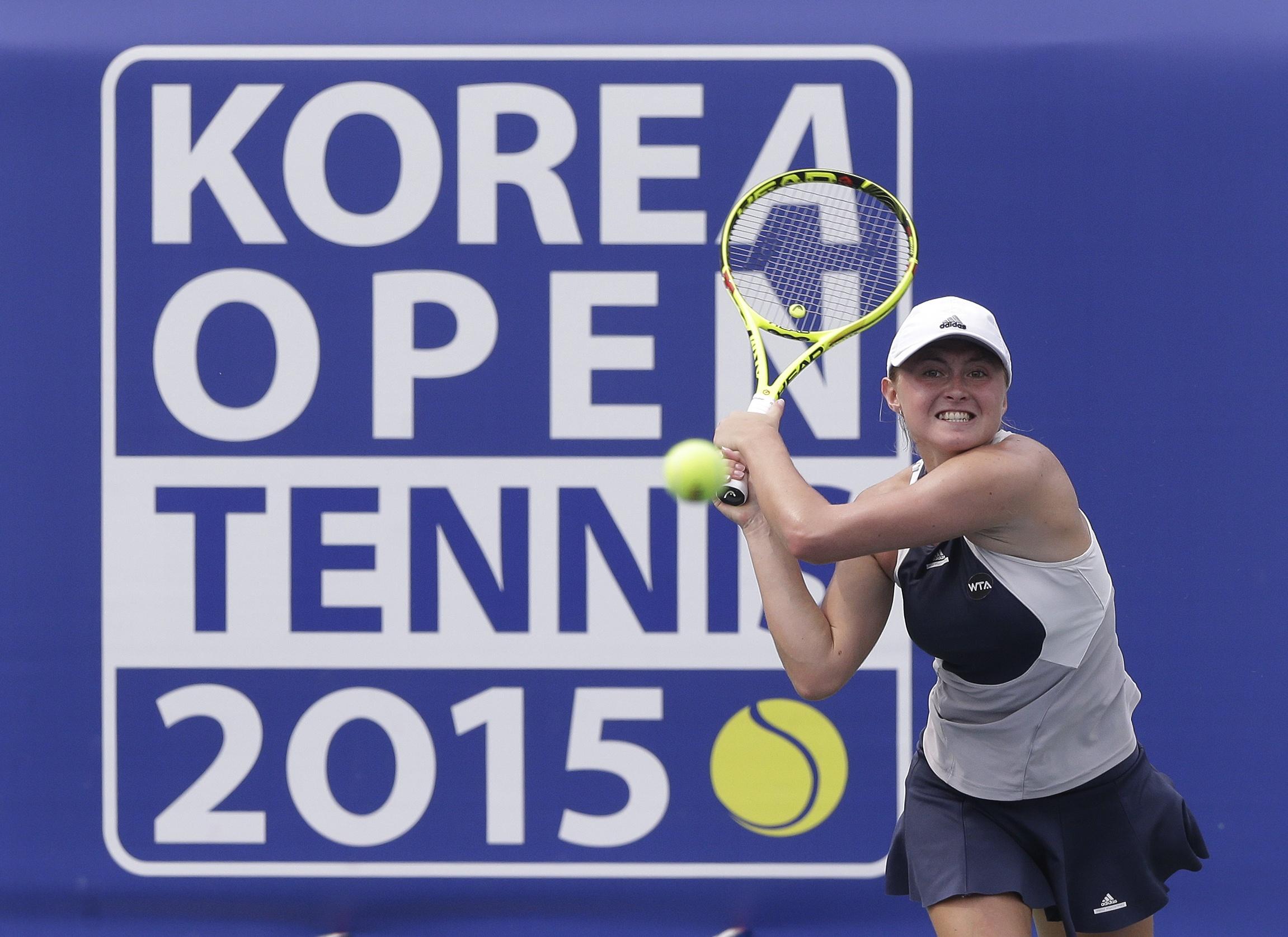 Aliaksandra Sasnovich of Belarus returns a shot against Anna Karolina Schmiedlova of Slovakia during the semifinal match of the Korea Open tennis championships in Seoul, South Korea, Saturday, Sept. 26, 2015. (AP Photo/Ahn Young-joon)