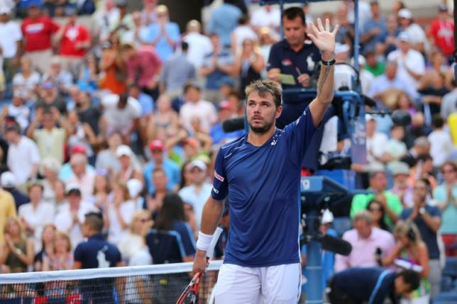 Sep 7, 2015; New York, NY, USA; Stan Wawrinka of Switzerland celebrates the win against Donald Young of the United States on day eight of the 2015 U.S. Open tennis tournament at USTA Billie Jean King National Tennis Center. Mandatory Credit: Anthony Gruppuso-USA TODAY Sports