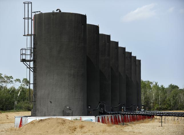 Storage tanks at Maidstone well site about 60 kilometres east of field office during a tour of Gear Energy's well sites near Lloydminster, Saskatchewan August 27, 2015.  REUTERS/Dan Riedlhuber