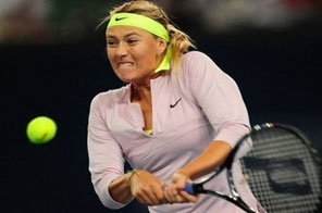 Russia's Maria Sharapova hits a backhand return against China's Peng Shuai in the third round of the China Open in Beijing. Sharapova became the latest upset victim at the China Open on Wednesday, while compatriots Nikolay Davydenko and Svetlana Kuznetsova sailed into the quarterfinals in Beijing. Source: AFP/Frederic J. Brown