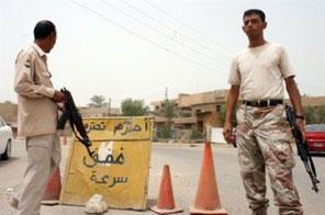 Sahwa militiamen guard a checkpoint in Baghdad Source: AFP