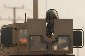 A US soldier mans an armoured vehicle at the site of a suicide attack in Kabul, Afghanistan. Source: AP