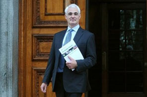 Britain's Chancellor of the Exchequer Alistair Darling poses for photographs with his pre-budget report outside the Treasury, in London, in December. Darling warned on Saturday that Britain faces its toughest spending cuts in two decades if the ruling Labour party wins this year's general election Source: AFP