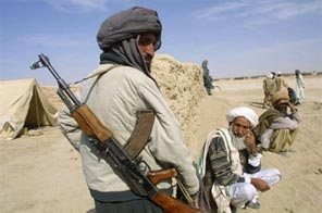 File photo shows a member of a Taliban militia watching over Afghan refugees near the Afghanistan-Iran border. Some 2.1 million people have died either directly or indirectly from armed violence over the last three years as talks on a global arms trade treaty have stalled, campaigners have said. Source: AFP