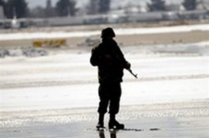 An Afghan army soldier stands guard near a military airport in Kabul. A suicide attacker has targeted Kabul's military airport, an officer with the International Security Assistance Force has said. Source: AFP