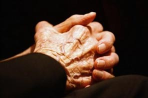 The hands of an elderly person. Scientists working in seven countries announced they had uncovered variants of three genes which play a role in Alzheimer's, a discovery that should throw open many new avenues for tackling this tragic, mind-killing disease. Source: AFP