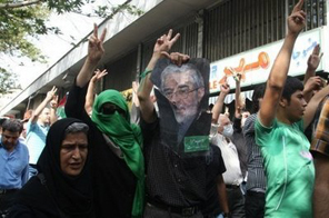 Iranian opposition supporters chant slogans in support of opposition leader Mir Hossein Mousavi during a rally in Tehran Source: AFP