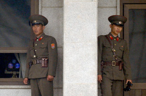 North Korean soldiers look at the South side at the truce village of Panmunjom in the demilitarised zone dividing two Koreas on June 9, 2009. North Korea said it would use its nuclear weapons both to defend itself and to carry out a merciless reprisal for any attack by its enemies. Source: AFP