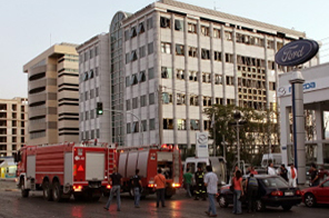 Firebrigade trucks are seen by the damaged Athens Stock Exchange building after a powerful bomb exploded there on September 2, 2009. Two homemade bombs went off early Wednesday in Athens and Thessaloniki, causing material damage and slightly wounding a woman, police said. The bomb in Athens exploded in front of the stock exchange after a warning call to a newspaper enabled police to cordon off the neighbourhood. A woman was slightly injured by breaking glass. The powerful blast in a stolen car destroyed six other vehicles and damaged the front of the stock exchange building. Source: AFP