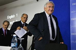 International Monetary Fund's Managing Director Dominique Strauss-Kahn (R), Egyptian Finance Minister and Chairman of the IMFC Youssef Boutros-Ghali (C) and IMF's First Deputy Managing Director John Lipsky (L) walk on stage at the Istanbul Congress Center in Istanbul, Turkey. The International Monetary Fund took on a bigger global role Sunday Source: AFP